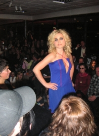 Wendalin in a blue dress taken from the audience.